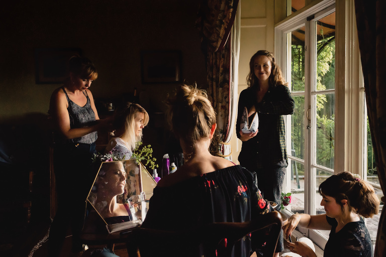 The bride and her bridesmaids get ready at Buckland House in North Devon