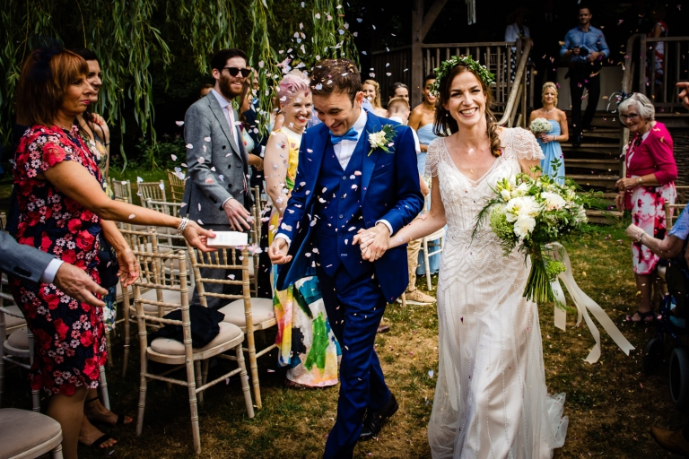 Confetti over the couple Somerset wedding photographer Michael Riley