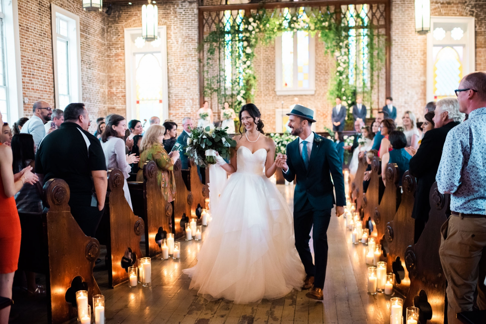 the couple leave their wedding in New Orleans
