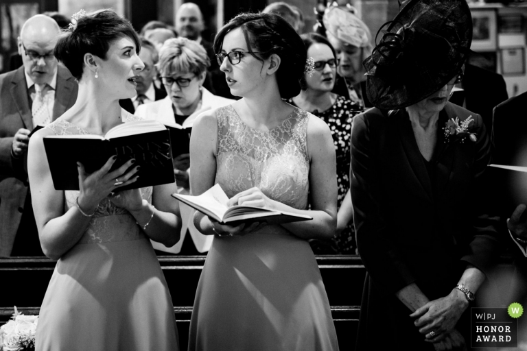 Documentary wedding photography award winning image of bridesmaids in church