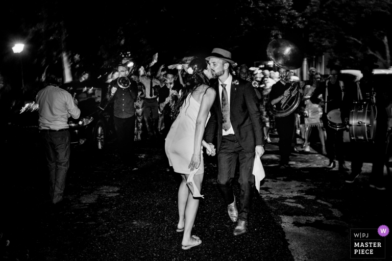 The couple lead the second Line Parade at their wedding in New Orleans